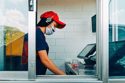 webbigstock-Fast-Food-Cashier-In-Drive-Thr-371564920.jpeg