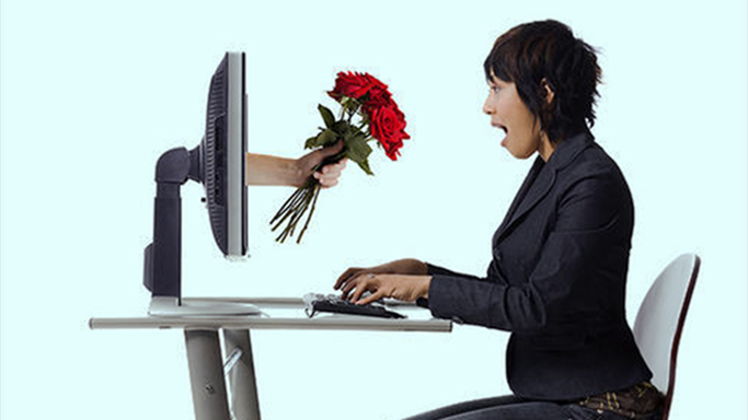 Woman-DeskScreenFlowers.jpg