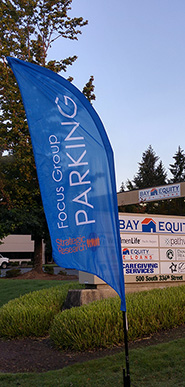 Focus Group Parking Flag in front of the Bay Equity Building